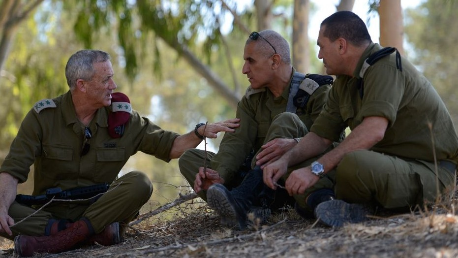 IDF Chief of Staff Benny Gantz (left) and South Command Chief Sami Turgeman (center), seen during a visit to the Givati Brigade near the Israeli border with Gaza, August 2, 2014. (Photo credit: Judah Ari Gross/IDF SPokesperson/FLASH90)