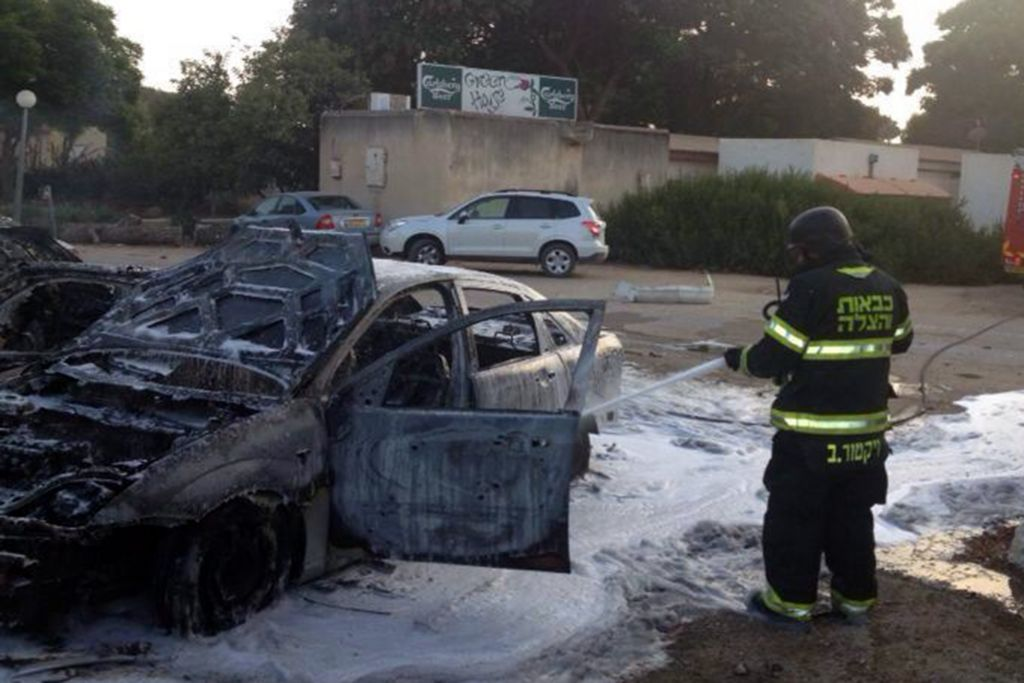 Firefighters try to extinguish the fire where a rocket landed and killed a 4-year-old boy at a kibbutz in southern Israel on August 22, 2014 (Photo credit: Southern Region Fire Department Spokesperson)