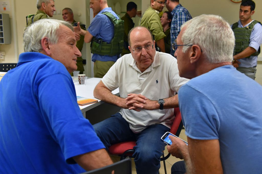 Defense Minister Moshe Ya'alon meets with local council chiefs from communities near the Gaza border at Sha'ar HaNegev Regional Council on August 23, 2014. Photo by Ariel Hermoni/Ministry of Defense/Flash90