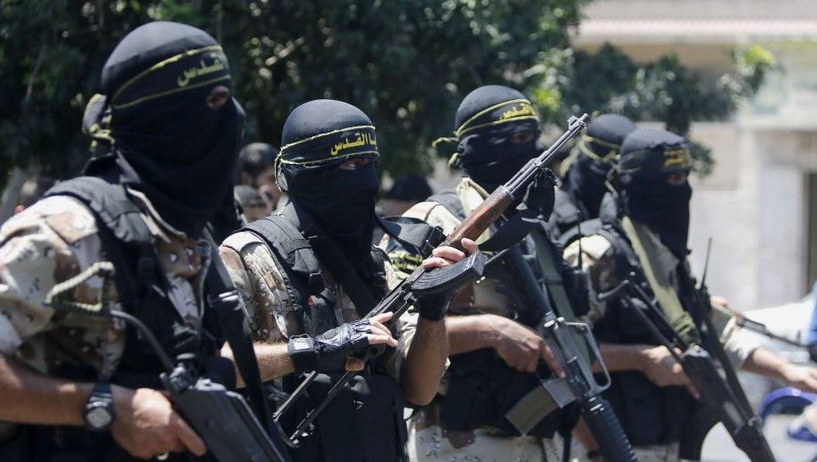 Masked militants of the Islamic Jihad group march during the funeral of their comrade Shaaban Al-Dahdouh, whose body was found under the rubble Tuesday, in Gaza City on Wednesday, Aug. 6, 2014. (Photo credit:AP/Hatem Moussa)