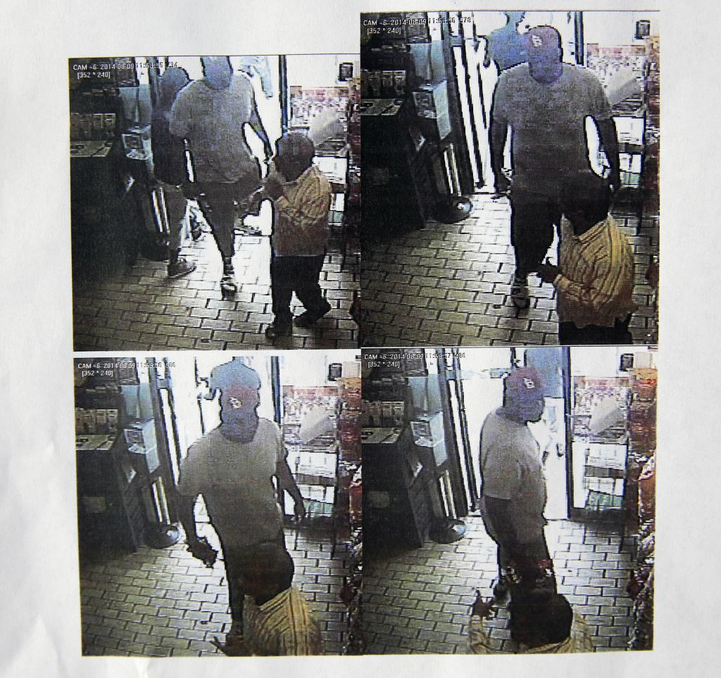 These images provided by the Ferguson Police Department show security camera footage from a convenience store in Ferguson, Mo., on Aug. 9, 2014, the day that Michael Brown was fatally shot by a police officer. A report released Friday, Aug. 15, 2014, by Ferguson Police Chief Thomas Jackson says the footage shows a confrontation between Brown and an employee at the store. The report says that Brown and his friend, Dorian Johnson, stole a box of cigars from the store shortly before Brown's death. (photo credit: AP Photo/Ferguson Police Department)