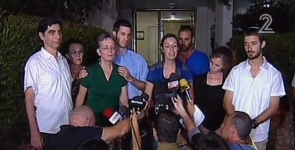 The family of Givati Brigade officer Hadar Goldin speaks to the press, August 2, shortly before they were told of his death (screen capture: Channel 2)