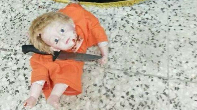 A photo of a decapitated doll uploaded to Twitter by supporters of the Islamic State, August 25, 2014. (photo credit: Twitter)