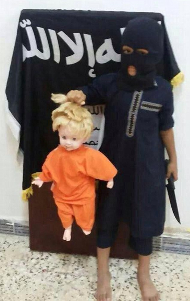 An image of a child holding up a doll which was uploaded to Twitter Monday is reminiscent of the beheading of US journalist James Foley by Islamic State fighters (photo credit: Twitter)