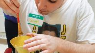 A JCC participant paints an Elijah's Cup. Courtesy of the St. Paul JCC