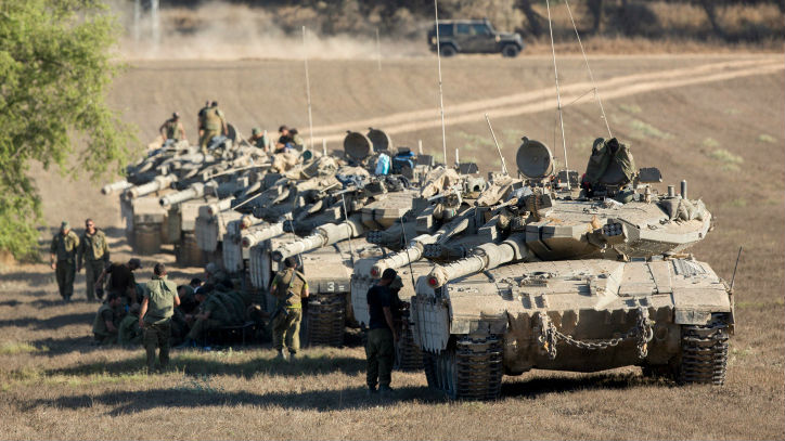 A convoy of IDF tanks park at a deployment area near the border with the Gaza Strip on August 2, 2014, (photo credit: Yonatan Sindel/Flash90)