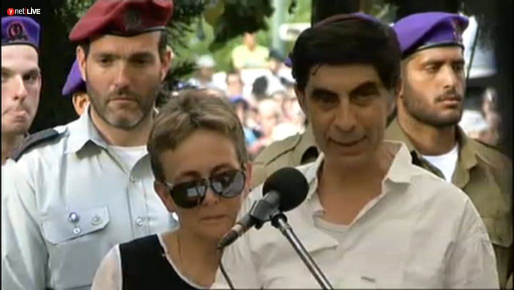 Simcha Goldin speaking at the funeral of his son Hadar at the Kfar Saba cemetery Sunday August 3, 2014. (Screen capture: Ynet)