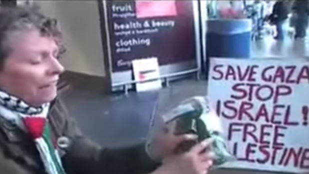 Protest against Israeli products at a British Tesco supermarket, July 2014. (screen capture: YouTube/Kashif Raza)