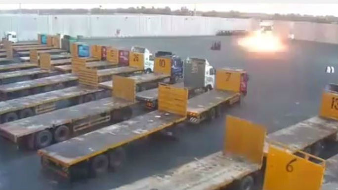 A rocket explodes in the Kerem Shalom border crossing compound, August 10, 2014. (screen capture: YouTube/zafat 1986)