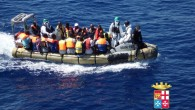 In this handout picture released by the Italian Navy on September 14, 2014, migrants sit in a boat during a rescue operation off the coast of Sicily. (Illustrative photo credit: AFP/ MARINA MILITARE)