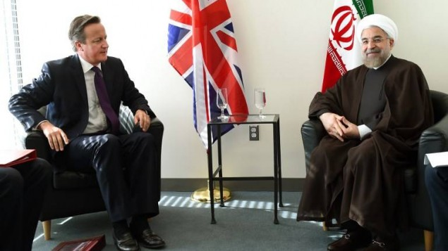 David Cameron et Hassan Rouhani (Crédit : AFP PHOTO / POOL/ Timothy A. CLARY)