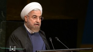 Iranian President Hassan Rouhani addresses the 69th session of the United Nations General Assembly September 25, 2014 at the United Nations in New York. (Photo credit: AFP/Don Emmert)