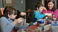 The author cooking with her children. Courtesy of Gabrielle Kaplan-Mayer