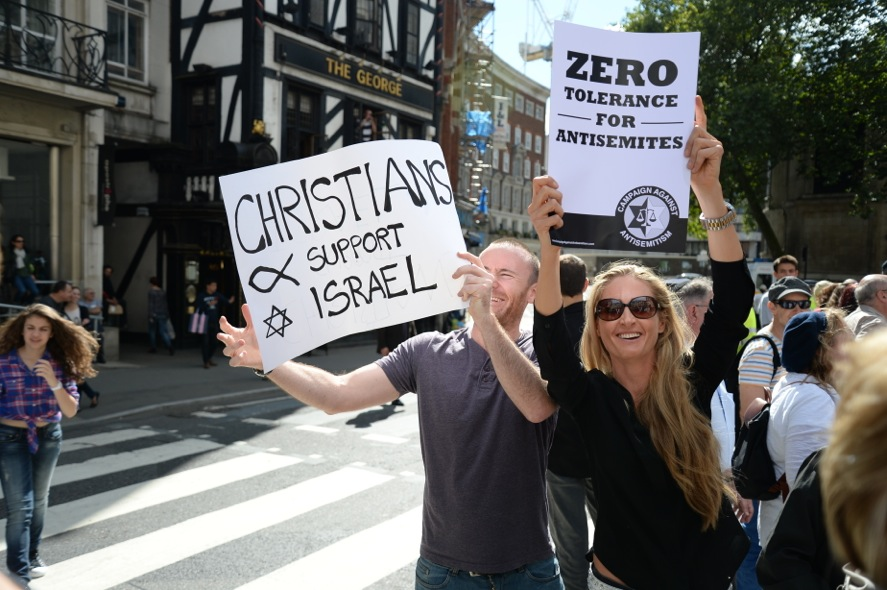 Protesters hold signs stating 'Zero Tolerance for Antisemites' at the August 31, 2014 rally in London against anti-Semitism. (courtesy Adam Arnold)