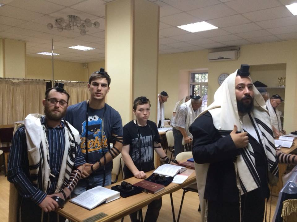 Chabad Rabbi Mendel Cohen (far right) and his three-times daily minyan in Mariupol. (courtesy)