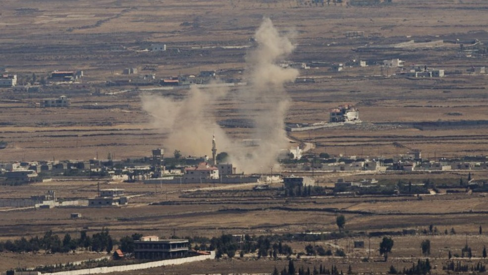Illustrative: Smoke rises following an explosion in Syria's Quneitra province as Syrian rebels clash with President Bashar Assad's forces, seen from the Israeli-controlled Golan Heights in 2014. (AP/Ariel Schalit, File)