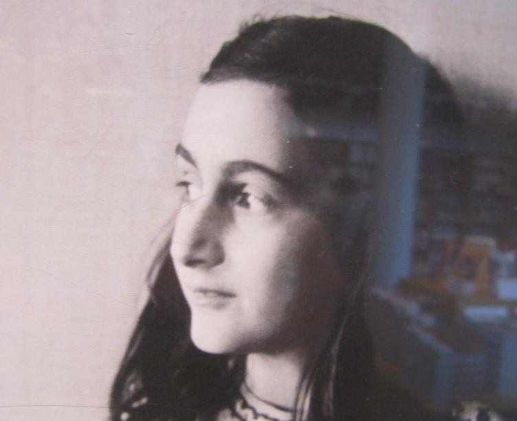Photograph taken in the Anne Frank House book shop with her image and translated copies of the diary in the background (photo credit: Matt Lebovic)