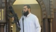 Screenshot from MEMRI video of Gaza imam brandishing rifle during a sermon on Augusyt 29, 2014.