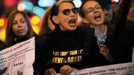 """Protesters raise their voices Monday night at opening of Met's """"The Death of Klinghoffer."""" Getty Images"""