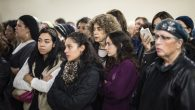 Mourners observe the body Karen Mosquera during her funeral Monday. Getty Images