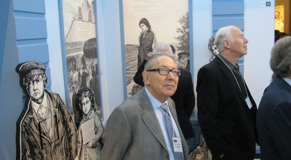 Brandeis' Antony Polonsky, chief historian of the museum, visits the museum's core exhibition. JTA
