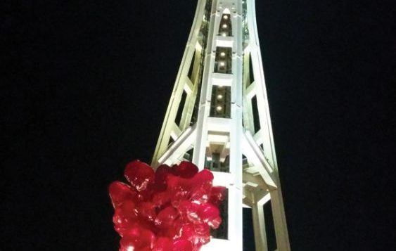 A Dale Chihuly sculpture set against the Space Needle at night. Amy Larson