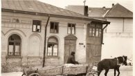 "Yale Strom. ""Passing the Village Synagogue, Dorohoi, Romania, 1985."" Courtesy of Anne Frank Center"