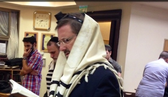 Yesh Atid MK Dov Lipman attends the morning prayers at the Har Nof Bnei Torah synagogue on November 19, 2014. (photo credit: Courtesy)