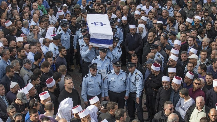 Israeli police officers carry the coffin of their comrade Zidan Saif, 30, a member of Israel's Druze minority, during his funeral in his northern home village of Yanuh-Jat, on November 19, 2014.  (photo credit: AFP/JACK GUEZ)