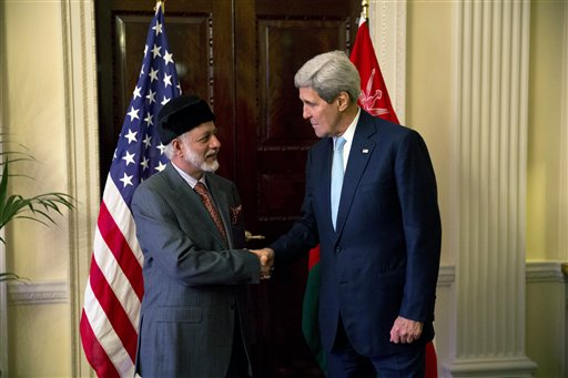 US Secretary of State John Kerry, right, and Oman Foreign Minister Yusuf Bin Alawi bin Abdullah, meeting at the official residence of the US ambassador to Britain, Winfield House, in London, Tuesday, Nov. 18, 2014. (photo credit: AP/Matt Dunham)