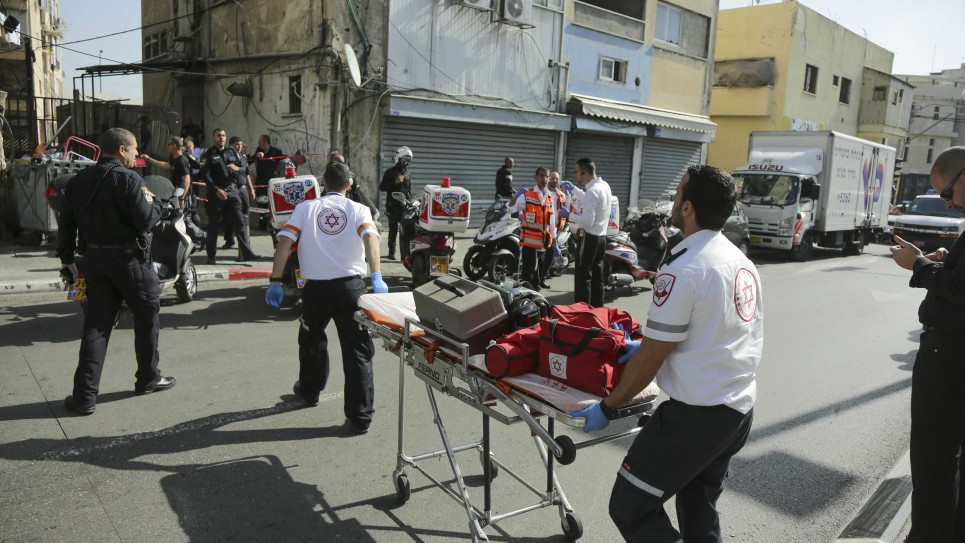 Medics attending to a stabbed soldier after a terror attack