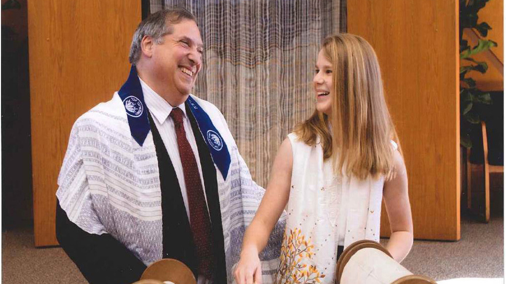 Rabbi Nat Ezray with a bat mitzvah. (photo credit: Scott Lasky)