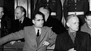 Nazi war criminals Rudolf Hess (left) and Joachim von Ribbentrop in the defendants' box during the 1946-7 Nuremberg trials. (Truman Library/Wikipedia)