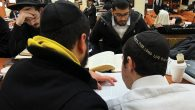 "Chabad yeshiva students poring over texts this week in the shul/study hall at ""770."" Michael Datikash/JW"