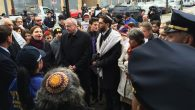 Members of several Jewish institutions in Riverdale and Kingsbridge gather at a police precinct in the Bronx Monday.