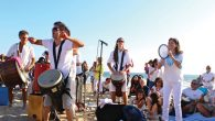Rabbi Naomi Levy and the Nashuva band drum playing on the beach.  Phyllis Osman