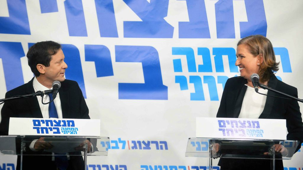 Tzipi Livni and Isaac Herzog hold a joint press conference in Tel Aviv on December 10, 2014, announcing a unity deal. (photo credit: Flash90)