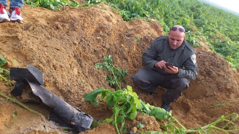 A rocket fired from the Gaza Strip on Friday December 19, 2014 lands in an open area in the Eshkol region. (Photo credit: Israel Police)