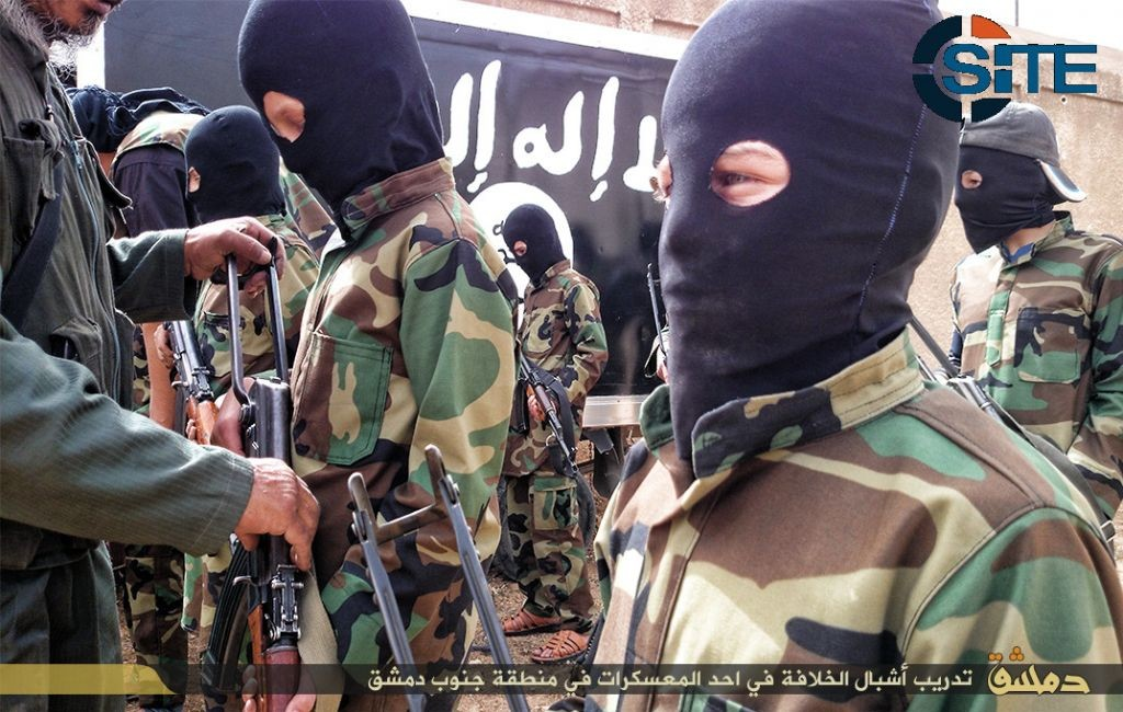 """""""Cubs of the Caliphate."""" Children are seen receiving military training by Islamic State militants in a camp near Damascus, Syria, December 6, 2014 (SITE Intel Group)"""