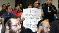 Parents protest at an East Ramapo school board meeting on Dec. 9, three weeks after a state report came out. Michael Datikash/JW