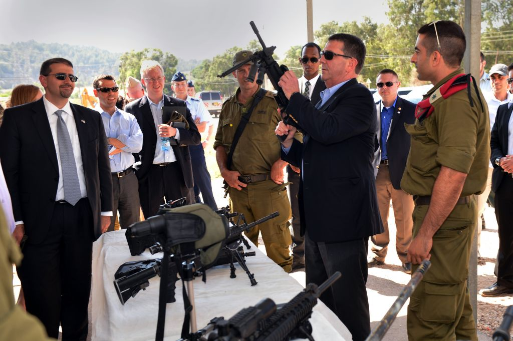 Ashton B. Carter, second from right, examines one of the weapons of the Israel Defense Force at a display at Mitkan Adam Army Base in Israel on July 21, 2013. (photo credit: Sgt. Aaron Hostutler, US Marine Corps/Department of Defense)