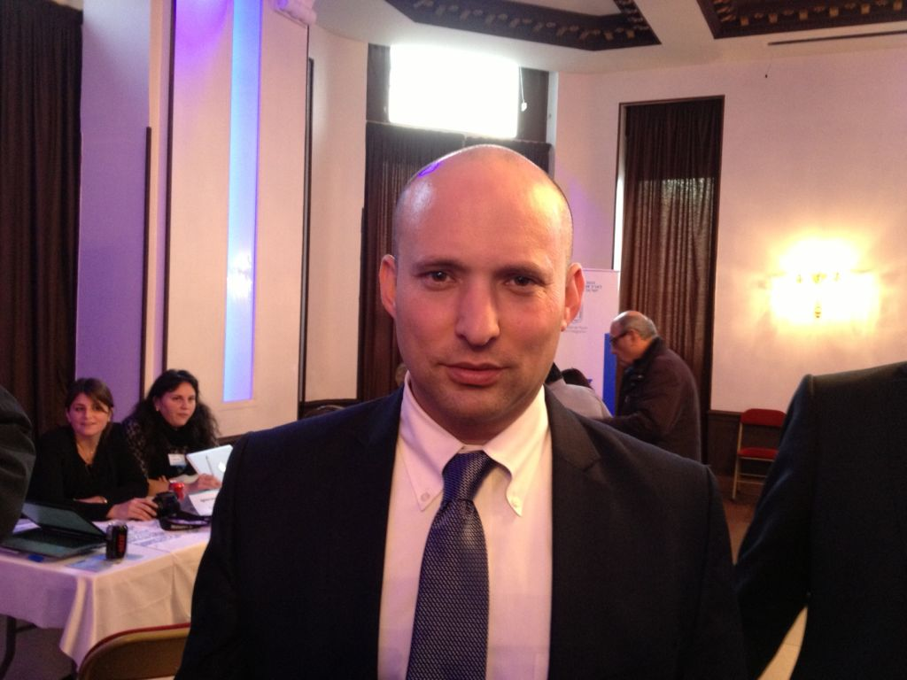 Economy Minister Naftali Bennett in Paris on January 11, 2015. (photo credit: Elhanan Miller, Times of Israel staff)