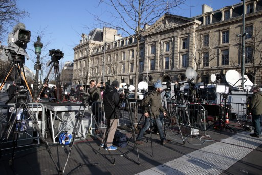 The press are on standby for the start of a big march at the Place de la Republique on January 11, 2015, in Paris. More than a million people and dozens of world leaders were expected to march through Paris in a historic display of global defiance against extremism after jihadist attacks on Paris last week which left 17 dead. (photo credit: AFP/JOEL SAGET)