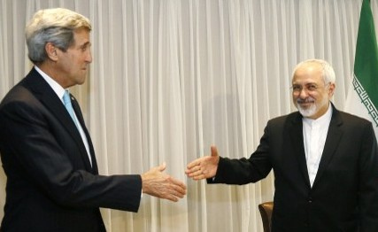 Iranian Foreign Minister Mohammad Javad Zarif shakes hands on January 14, 2015 with US State Secretary John Kerry in Geneva. (Photo credit: AFP/ POOL / RICK WILKING)