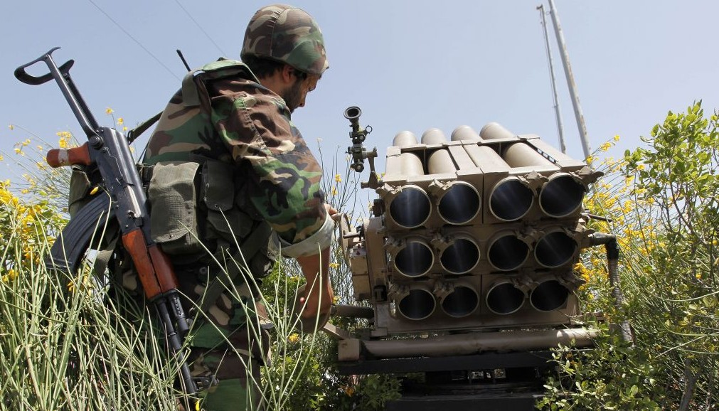 In this May 22, 2010 file photo, a Hezbollah fighter stands behind an empty rocket launcher while explaining various tactics and weapons used against Israeli soldiers on the battlefield (AP/Hussein Malla)