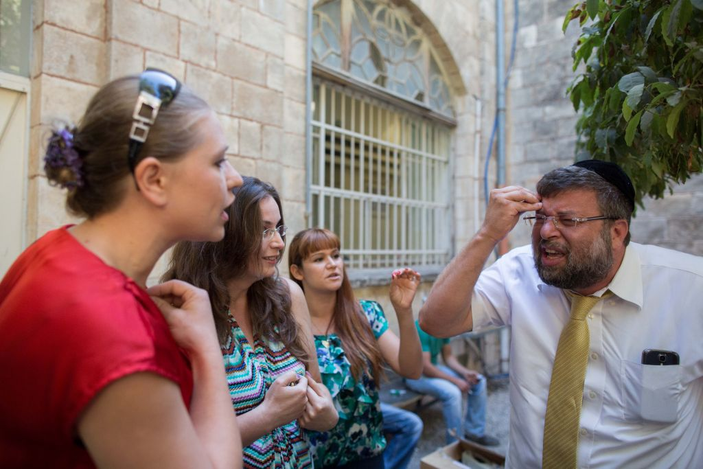 Israel's growing spiritual caregiving network aims to reduce tensions between religious and secular by minimizing religious values out of pastoral care (photo credit: Yonatan Sindel/Flash 90)