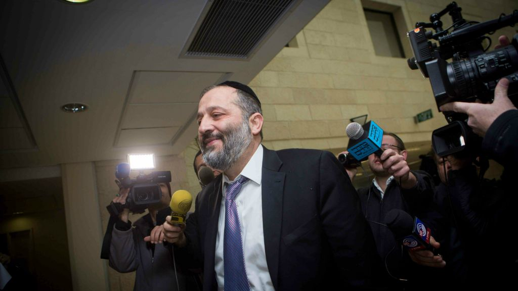 Shas leader Aryeh Deri arrives at the party's Jerusalem headquarters, January 12, 2015. (Miriam Alster/FLASH90)