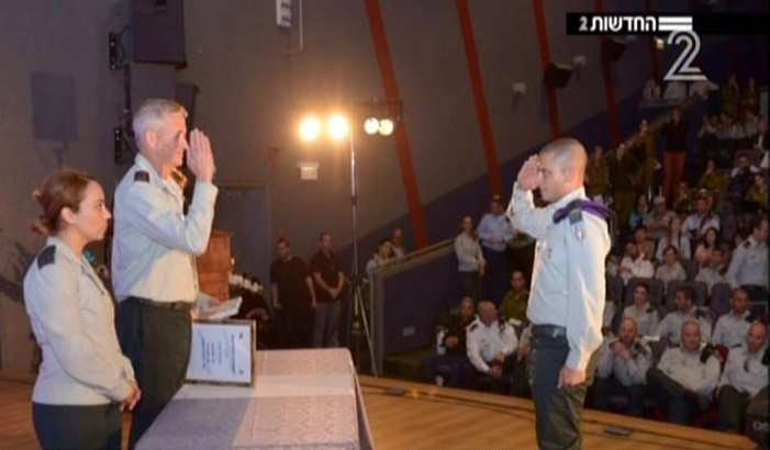 Yochai Kalangel, left, saluting IDF chief Benny Gantz. (Screen capture: Channel 2)