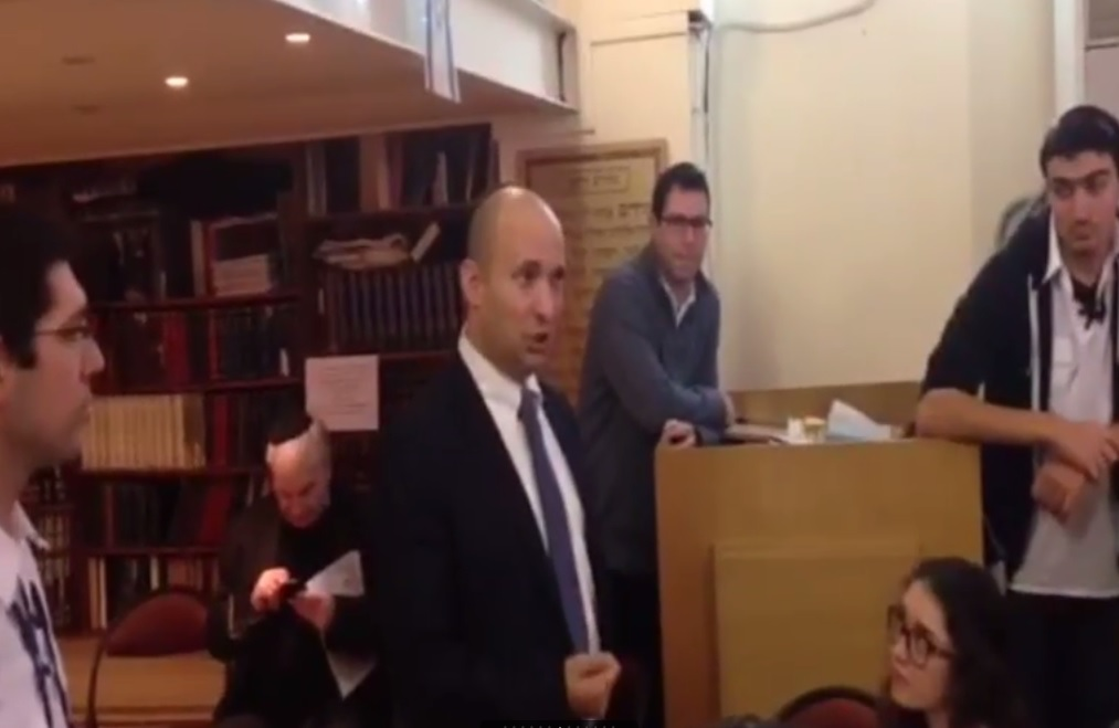 Economics Minister Naftali Bennett speaks to French youths in Paris on January 11, 2015. (screen capture: Channel 2)