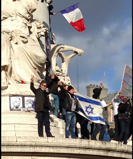 Demonstrators at Paris's Place de la Republique wave an Israeli flag (photo credit: John Macarthur)